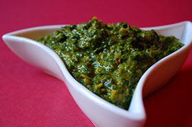 bowl of bright green chermoula