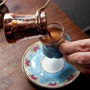 pouring a cup of turkish coffee