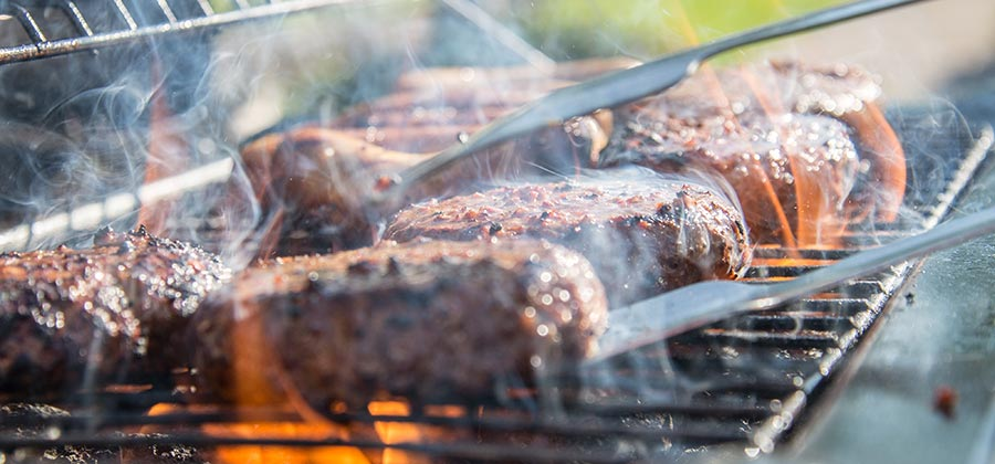 close up of grilled meat on griddle
